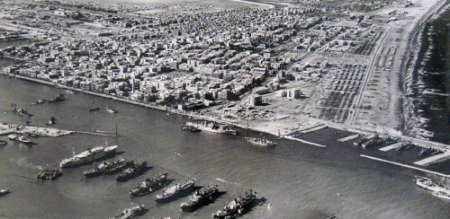 The main battles occurred in Port Said, which played a historic role in the Suez Crisis. The city lies in north east Egypt extending about 30 km (19 mi) along the coast of the Mediterranean Sea, north of the Suez Canal. It was established in 1859 during the building of the Suez Canal.