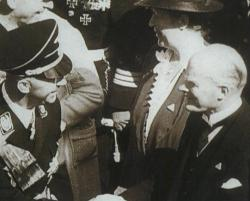 Gustav Krupp greets Reichsführer SS Heinrich Himmler at the launch of Navy cruiser Prinz Eugen from the Krupp Germania Werft yard at Kiel