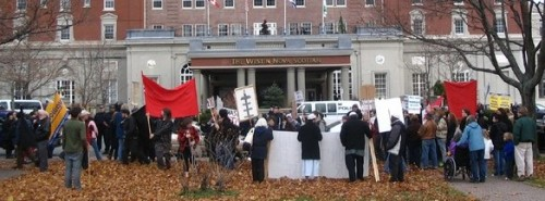 Haligonians mount a vigorous protest against the First Halifax International Security Forum, funded by DND and ACOA.