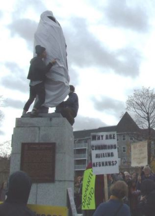 "Commemorative statue shamelessly honouring the Genocidaire Cornwallis is covered by anti-war activists at protest against the Halifax International Security Forum, November, 20010. The rally renamed ""Cornwallis Park"" Peace & Freedom Park as a tribute to the heroic struggle of the First Nations against imperialist war and conquest, including the present-day stand of the Innu against NATO training flights in Labrador."