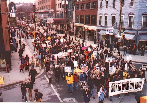 Halifax, March 20, 2003. Hundreds upon hundreds of people take to the streets to condemn the U.S. invasion of Iraq the night before.
