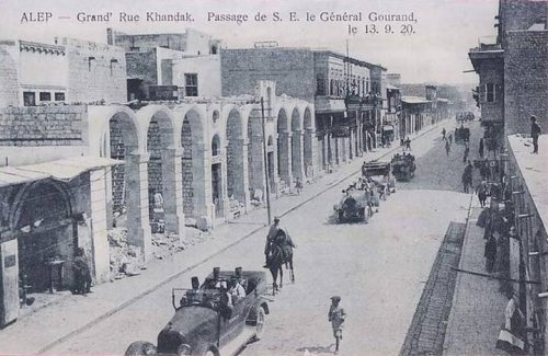 """French General Gouraud marches through Aleppo. Just as British General Allenby had taken a stroll in the old city of Jerusalem and declared, """"Today the Crusades have come to an end,"""" his French counterpart in Syria, upon taking Damascus went straight to the tomb of Salahuddin. Standing at that most green-draped of tombs in the Ummayad mosque and, in what must be one of the most inflammatory statements in modern Middle East history, Gouraud placed his boot on his grave and declares to the tomb: """"Saladin, we have returned."""" Or: """"Look Saladin, we are back!"""". Another account has him declaring """"The Crusades have ended now! Awake Saladin, we have returned! My presence here consecrates the victory of the Cross over the Crescent."""""""