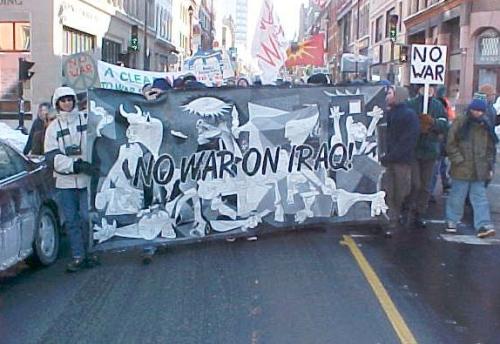 Guernica banner leads demonstration of over 1,500 people on Barrington Street in Halifax, Nova Scotia | Photo by Derek vanderMolen, Halifax Peace Coalition