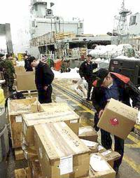 Crew and support staff load supplies aboard destroyer HMCS Iroquois on Thursday February 20, 2003. Captain Maddison and the crew are preparing the ship for Monday's deployment to the Middle East in support of Canada's Operation Apollo. Sailors laden with supplies stream on to the aging warship as they get ready for a six-month mission in the Persian Gulf. Activity on this historic dock hasn't ceased since last Thursday when the captain and crew were told they had 10 days to prepare for the deployment. (CP PHOTO/Scott Dunlop)