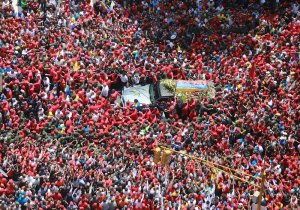 Millions of Venezuelans take to the streets to pay tribute to President Hugo Chávez, as his body is taken from the military hospital where he died to the National Military Academy to lie in state, March 6, 2013