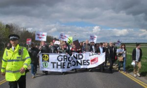 Over 400 protesters march to the perimeter fence of RAF Waddington, Lincolnshire to protest its use as a centre for drone piloting in Afghanistan | Matthew Cooper/PA