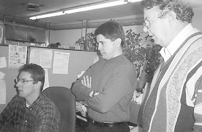 "MIke Vavra (left) takes Carlos Fernández De Cossío, Ambassador of the Republic of Cuba to Canada (centre) on a tour of the ""Discovering Nova Scotia's Natural History"" website, during his meeting with the editorial board of Shunpiking magazine, 30 October 1999"