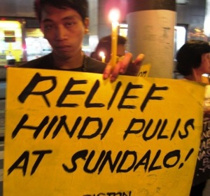 """Demonstrations in the Philippines on November 13, 2013 demand """"Relief, not police and soldiers."""""""