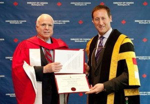 "Defence Minister Peter MacKay bestows an honorary doctorate from the Royal Military College, Kingston upon U.S. warmonger Sen. John McCain at the Canadian embassy in Washington, June 18, 2013. McCain was recognized for his ""dedication to our countries' bilateral relationship and to his extensive work in promoting international security,"" MacKay's office said in a release. 