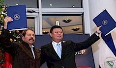 Nicaraguan President, Daniel Ortega  and Wang Jing from HKND Group,  after signing the canal framework  agreement. The development has  caused consternation in the Pentagon,  as it challenges U.S. dominance in  the region.