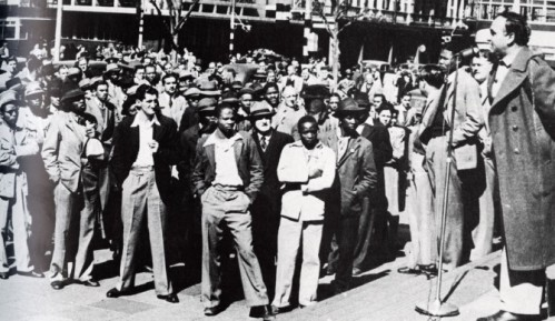 Nelson Mandela (second from right) of the ANC Youth League and Dr. Yusuf Dadoo of the Transvaal Indian Congress address a public forum on the steps of Johannesburg City Hall, 1945.