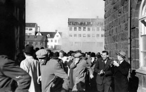 From the day of the Anti-NATO protests in Reykjavík. Police unleash tear gas against the people. On the west side of the House of the Althing. March 30th 1949 | Arnaldur Grétarsson & family, rights-holder to these photographs.