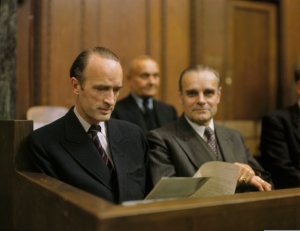 Defendant Alfried Krupp (left) reads a document while seated in the dock at a session of the Krupp Trial in Nuremberg. Krupp was tried and convicted as a war criminal. He served only three years of his twelve year sentence | Stadtarchiv Nürnberg