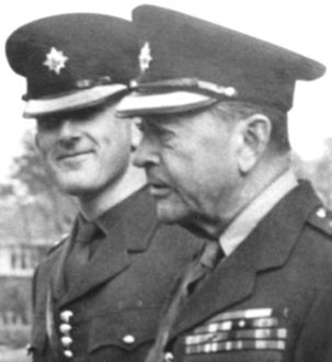 Colin Wallace (left) attending a parade with Field Marshal Lord Alexander of Tunis in 1972. Wallace was a British soldier and psychological warfare specialist who was one of the members of the Intelligence-led 'Clockwork Orange' project, which is alleged to have been an attempt to smear various individuals including a number of British politicians in the early 1970s. Evidence from Wallace was used by the Barron Report, an Irish government inquiry into the Dublin and Monaghan bombings in May, 1974.