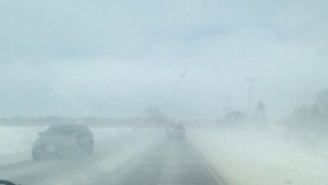 This photo was taken by CBC News reporter Shannon Martin from the dashboard of her vehicle as she approached Thursday's pileup south of Barrie, Ont. This image, which was not taken from the passenger seat, shows the kind of low visibility that snow squalls can create | Shannon Martin