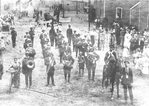 """1921 demonstration by steelworkers and the African community in Whitney Pier, Sydney, Cape Breton. Banner declares, """"Africa for the Africans!"""" Courtesy Beaton Institute and Shunpiking Magazine's Black History Supplement"""