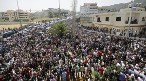 Tens of thousands of Syrians residing in Lebanon headed into Beirut to vote. In fact, so many Syrian citizens went to cast their ballots for their country's presidential election that they created traffic jams in Beirut due to the sheer size of numbers streaming into the Lebanese capital.