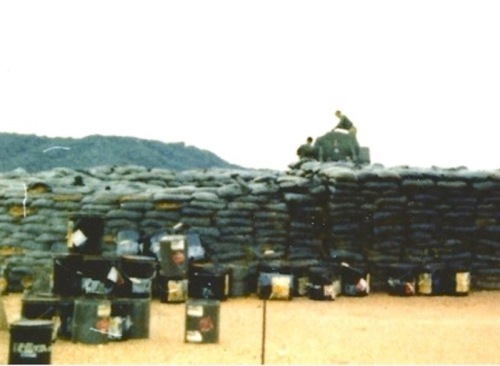 Barrels of unidentified U.S. chemicals lie strewn across land in the Northern Training Area, 1972. Courtesy of Robin Poe. (Click to enlarge)