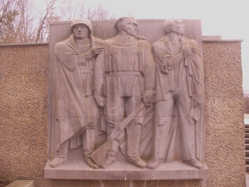 Monument to Polish partisans and German anti-fascist fighters in Berlin. The relief at right depicts a Soviet soldier, a soldier of the Armia Ludowa (Polish People's Army) and a German anti-Fascist | Wikipedia; Colin Smith