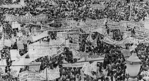 Mass rally at Central Station in Rio de Janeiro, Brazil, March 13, 1964, where President João Goulart outlined various progressive social, political and economic reforms. For his stands in the people's interests, he was overthrown in a US organized-coup shortly thereafter.