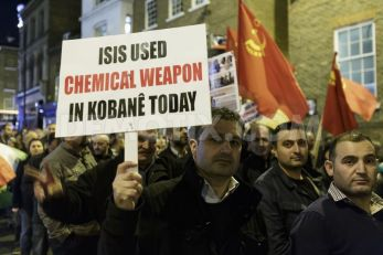 Kurds protest in London on Oct. 8 against assault on Kobani. Protests took place throughout Turkey, where 34 people were killed by the Erdogan regime, and Europe