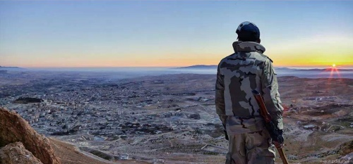 Hezbollah resistance fighter greeting the morning sunrise on the day of victory in Yabroud in the the hotly-contested Qalamoun Mountain region, March, 2014. That's what liberation looks like. (Click to enlarge)