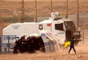 Kurdish boy v Turkish water cannon