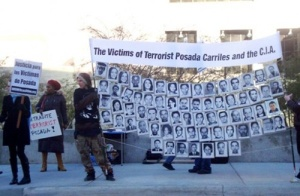Protesters outside the Carriles immigration hearing in El Paso, TEas demand his extradition to Venezuela and the release of the Cuban Five.