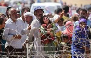 Syrian Kurdish refugees barred by barbed wire fence near Kobani