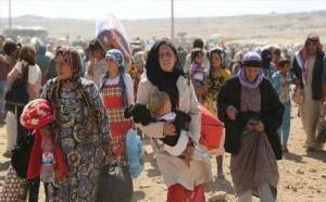 Syrian Kurdish refugees barred by Turkey near Kobani, October 2014