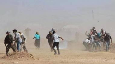 Kurds beseiged by Turkish water cannons at border facing Kobani