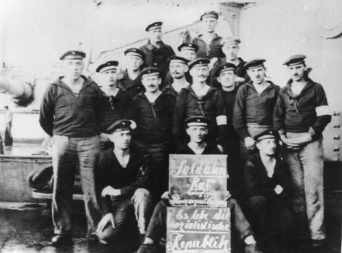 With the rebellion of the sailors and workers on 3 November 1918 in Kiel the November revolution started in Germany. On 6 November the revolutionary movement reached Wilhelmshaven, where another mutiny had taken place on October 29-30. The sailors and stokers were now pulling out all the stops to prevent the fleet from setting sail again and to achieve the release of their comrades. The mass protest now turned into a general revolt. Soldiers and workers brought public and military institutions under their control. When, against Souchon's promise, different troops advanced to quash the rebellion, they were intercepted by the mutineers and were either sent back or joined the sailors and workers. By the evening of 4 November, Kiel was firmly in the hands of approximately 40,000 rebellious sailors, soldiers and workers, as was Wilhelmshaven two days later. Photo shows the soldiers' council of the Prinzregent Luitpold. (Click to enlarge)