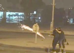 2014.11.Palestinian protestors fireworks