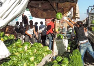 A watermelon market in Barzeh, Damascus. July 10, 2014