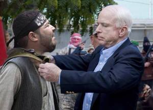The general decorates the terrorists – inside Syria. The photo was distributed by McCain's office.