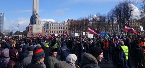In what has become an annual event in Riga, Latvia in recent years, supporters of Latvian Waffen SS troops hold a commemorative march on March 16, 2014. The support for Nazism and the rehabilitation of war Nazi criminals throughout Europe in the context of the U.S. imperialist aggression, war and attempts to isolate Russia underscores the necessity of the anti-Nazi resolution at the UN.