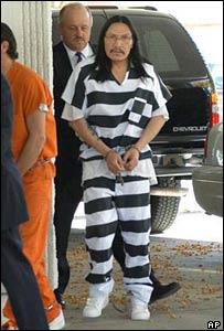 Leonard Peltier shackled