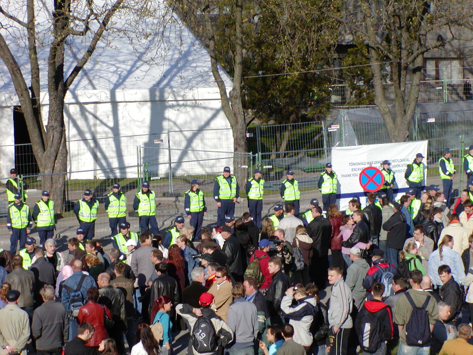 "Mass protests on April 26, 2007 against the removal of the famed Bronze Soldier of Tallinn, a World War II memorial commemorating the liberation of Estonia from Nazi Germany. Police cordon off the statue . The sign says ""archeological excavation"". 
