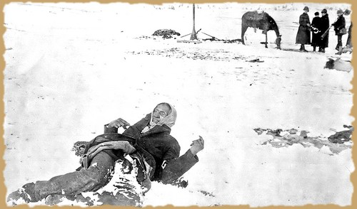 An iconic photo from the 1890 massacre at Wounded Knee of a dead and frozen Big Foot.