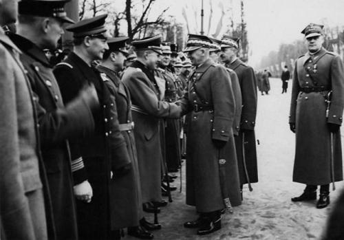 "A handshake between Polish Marshal Edward Rydz-Śmigły and the German attache, Major General Bogislav von Studnitz, at the ""Independence Day"" parade in Warsaw, November 11, 1938."