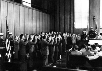 Photo shows 39 German-born scientists, including two Nazi scientists brought into the U.S. through Operation Paperclip, being granted U.S. citizenship on November 11, 1954 (the U.S. holiday of Veterans' Day).