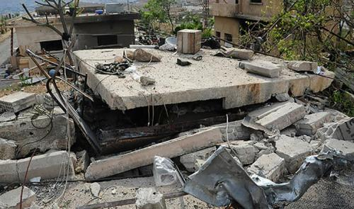 Photo broadcast on the Syrian agency SANA of damage caused by Israeli raids in rural Damascus in May, 2013