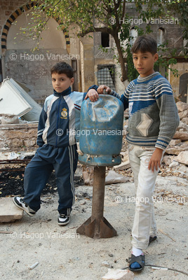 Kids beside unexploded Gas tube missile which shelled their neighborhood by terror groups. They call it (Hell Cannon) it has an enormous capacity for destruction. Aleppo, Syria 2013