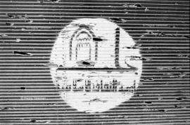 Logo, words in Arabic (Aleppo Capital of Islamic Culture 2006) most of shops painted in green with this logo in 2006. Aleppo, Syria 2013