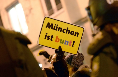 A protester holds a sign reading: 'Munich is colourful' in Munich | Andreas Gebert/EPA