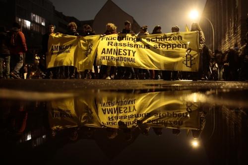Activists from Amnesty International protest in Berlin | Markus Schreiber/AP