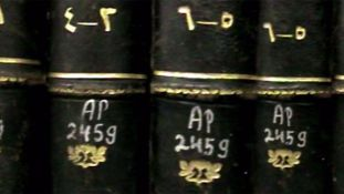 Books that belonged to Palestinians, marked as abandoned, in the National Library | Still from the film The Great Book Robbery