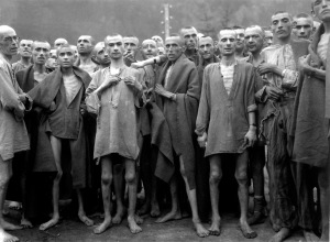"Starved prisoners, nearly dead from hunger, pose in concentration camp in Ebensee, Austria.  The camp was reputedly used for ""scientific"" experiments.  It was liberated by the 80th Division.  May 7, 1945. Roosevelt was informed about concentration camps in Central and Eastern Europe but he did nothing."