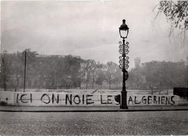 """Tagged on the Saint-Michel Bridge in 1961: """"Ici on noie les Algériens"""" (""""Here we drown Algerians""""). Dozens of bodies were later pulled from the River Seine 