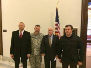 [L to R] Washington warmly welcomes the neo-Nazis, November 16-18, 2014. Photo shows Andrey Teteruk, commander of Myrotvorets (Peacemaker) punitive unit; Yuri Bereza (in military uniform), leader of Dneipr (Dnepr) Battalion and MP-elect for the Ukrainian Rada; US Senator John McCain; Seymon Semyonchenko, the head of Donbass Battalion and MP-elect. They were hospitably received by IRI (International Republican Institute) and NDI (National Democratic Institute), the international branches of the two main American political parties under the National Endowment for Democracy (NED) of the U.S. state.